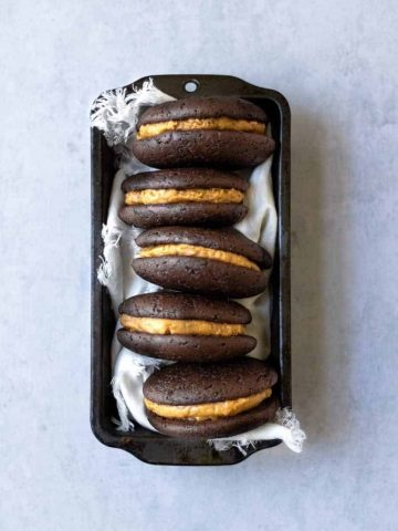 Chocolate whoopie pies with cookie butter filling in a loaf pan.