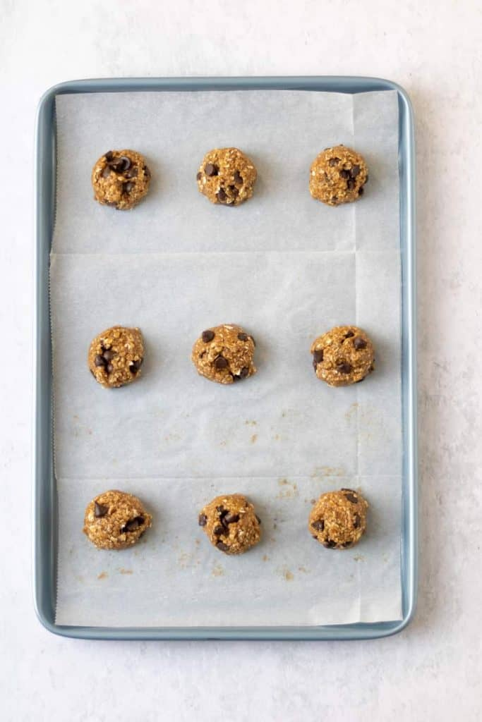 oatmeal cookies on a baking sheet before baking