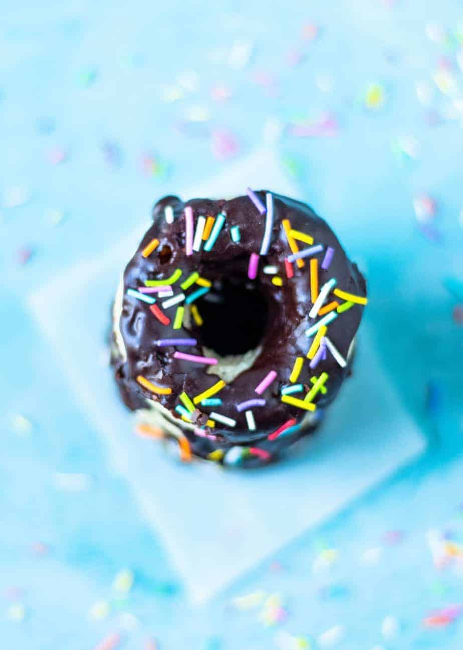 easy Baked donut recipe with chocolate glaze and colored sprinkles