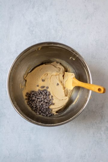 Mixing bowl with frosting and chocolate chips