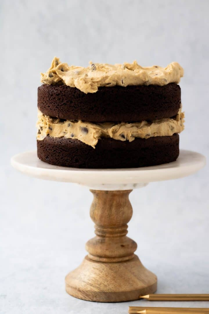 Stacked brownie cake with cookie dough frosting.