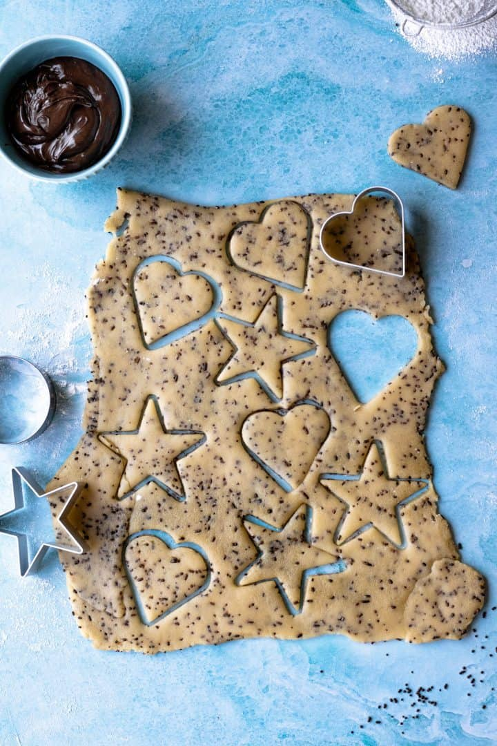 Linzer Cookie dough with cut out hearts and stars