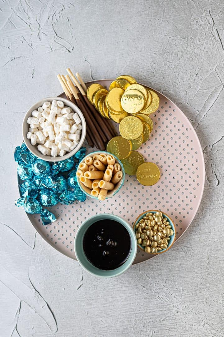 Hot cocoa board with chocolate and cookies for Chanukah