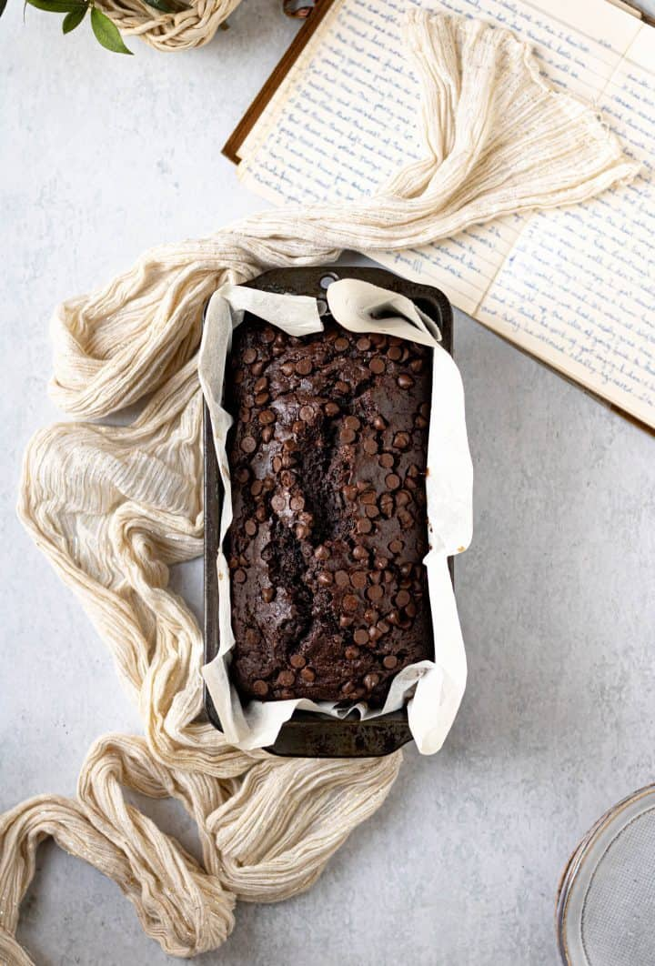 Double chocolate banana bread in loaf pan with cloth napkin