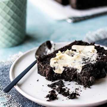 Slice of double chocolate banana bread slathered in butter