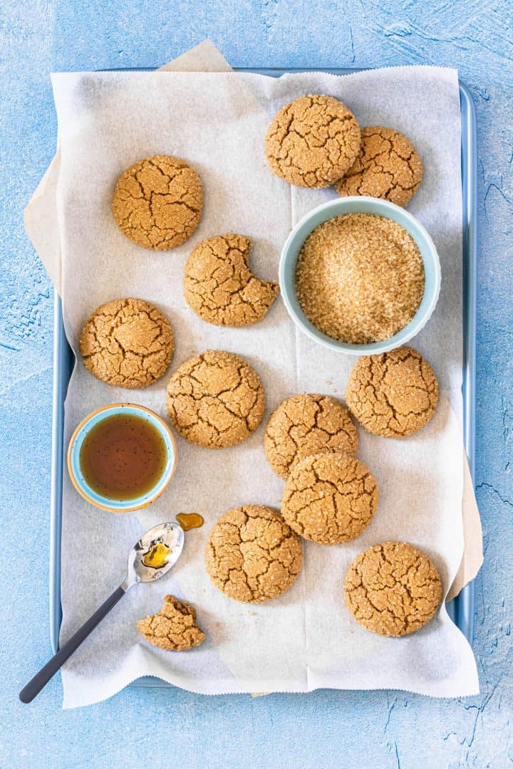 Maple cookies on a baking sheet with maple syrup