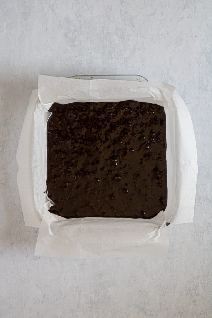 flourless brownies batter in a square baking dish