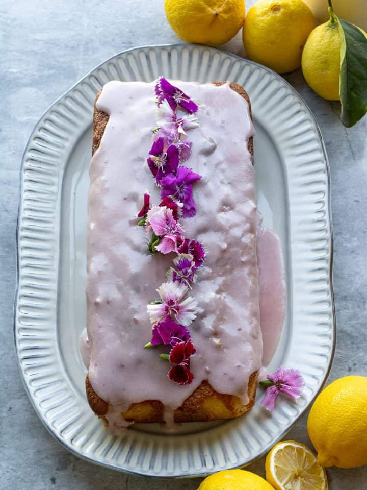 Lemon loaf recipe with strawberry glaze and edible flowers